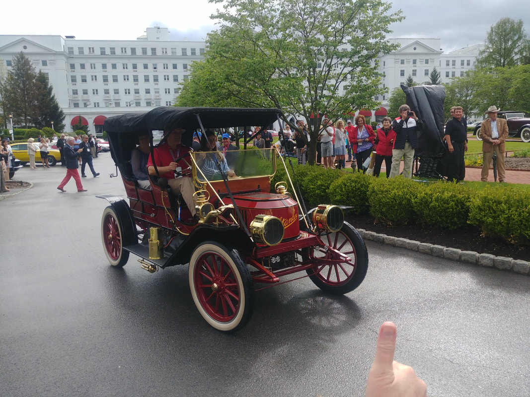 Brass era Stanley earns a thumbs up as it parades in front of the Greenbrier